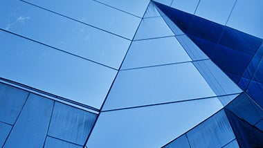 blue building with glass mirrored angular walls